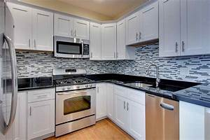 Pictures of kitchens with white cabinets and dark for Kitchen designs with white cabinets and black countertops