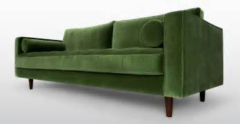 green sofa 11 pieces of 39 70s decor to give your home the grooviest retro vibe