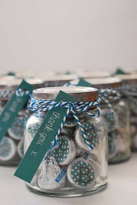clear jars filled with color coordinated hershey kisses