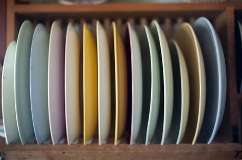 selection  dinner plates   wooden rack  stock image