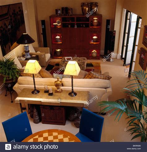 how to decorate a sofa table behind a couch birdseye view of lighted ls on console table behind