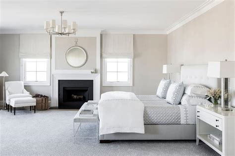 White And Gray Master Bedroom With Fireplace