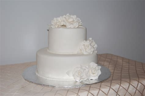 Two Tier White Wedding Cake With Open Roses