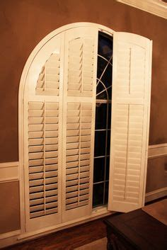 louvered real wood arched shutters  decorative frame  window   ft wide