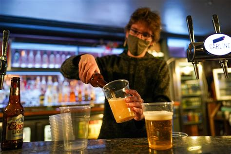 Midnight drinkers flock to Britain's beloved pubs as ...
