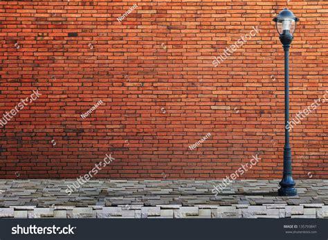 l post street on brick wall background