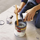 Mix up the epoxy paint   How to Epoxy Coat a Garage Floor