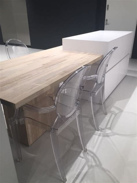 white silestone clad island solid wood table chairs