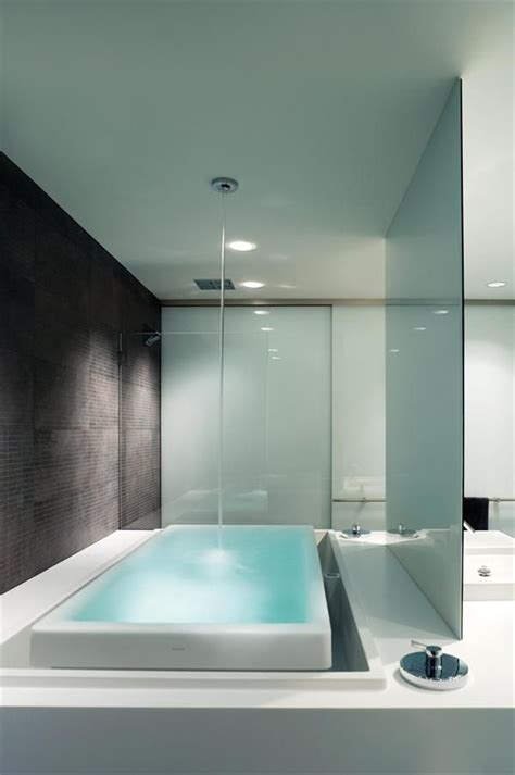 infinity tub  filled   ceiling  overflows   lit space
