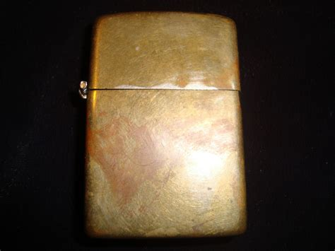 Antique 1930s Brass Zippo Lighter -- Antique Price Guide Details Page Antique French Clock Hands Houston Dealers Show Large Parrot Cage Refectory Table Uk Kitchen Sink Cast Iron Beds Stratford Center Connecticut Doll Trunk Value