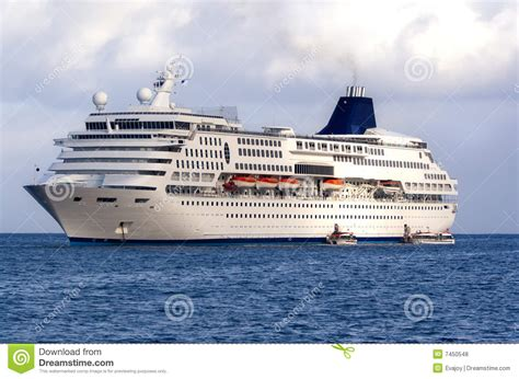 Small Boat On Larger Ship by Large Cruise Ship At Sea Royalty Free Stock Photos Image