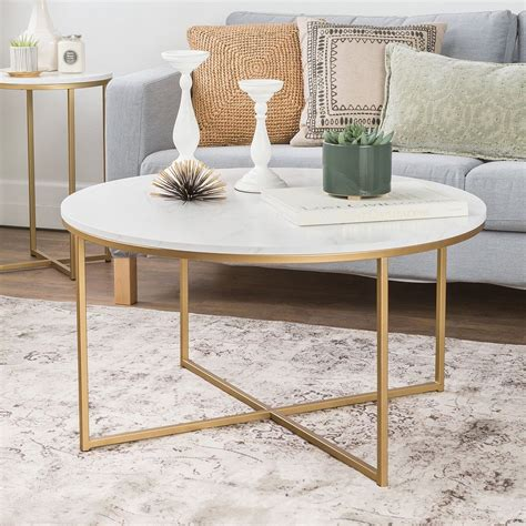 A coffee table is one of the most functional pieces of furniture in a home, but that doesn't mean that it here, we round up 12 of our favorite glass coffee tables that are sure to enhance your living from its antique gold finish to its striking fretwork, this coffee table is sure to elevate any living room. Alissa Coffee Table | Faux marble coffee table, Round ...