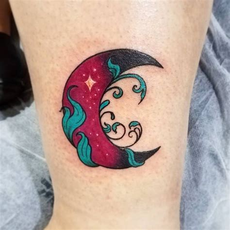 red  black crescent moon tattoo  leg