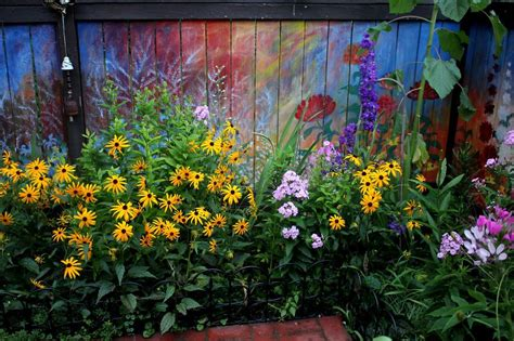 revived   garden fence  painting vivid flowers