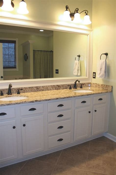 Bathroom Colors With White Cabinets by Antique Bronze Fixtures Bathroom White Cabinets White