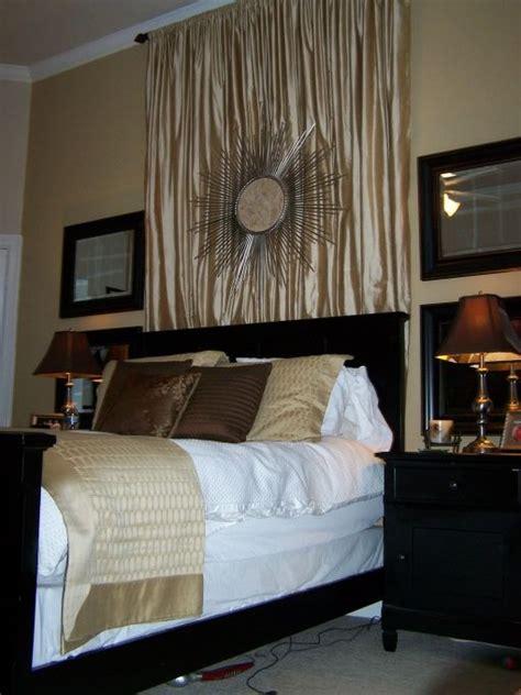 master bedroom  black furniture  pretty light gold