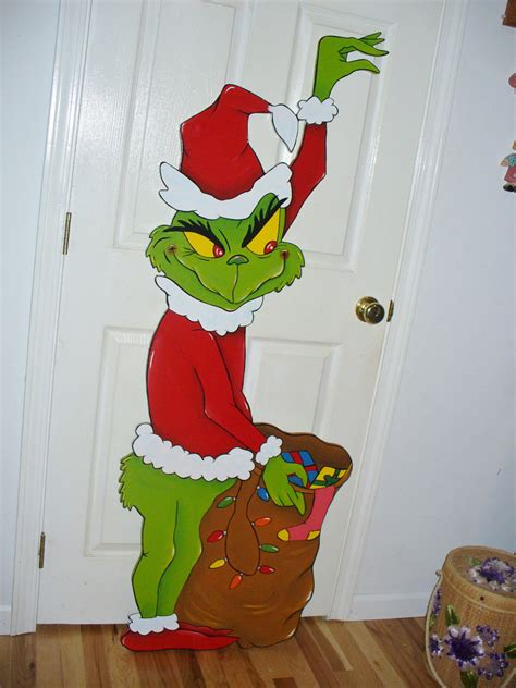 hand made grinch stealing christmas lights yard art