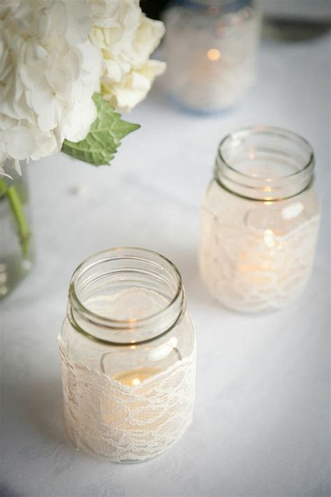 diy mason jar centerpieces wrapped with lace onewed com