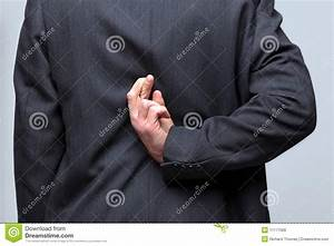 Man In A Suit Crossed His Fingers Behind His Back Royalty ...