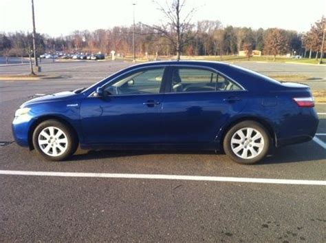 buy   toyota camry hybrid sedan  door