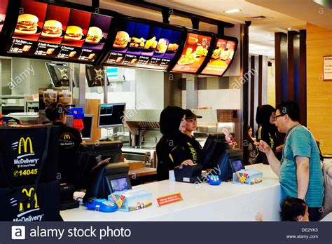 fast food cuisine customers ordering food at a fast food restaurant in
