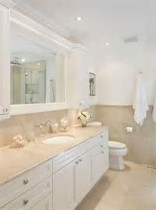 Woodharbor Cabinets by Travertine Flooring With White Cabinets Home Design Ideas