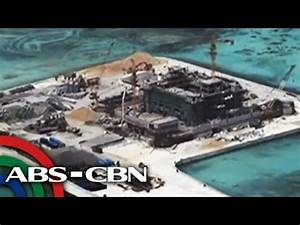 China continues reclamation in disputed waters - YouTube