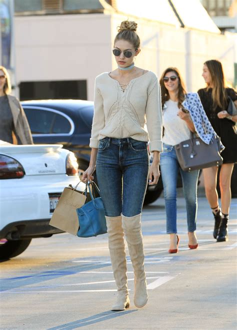 gigi hadid  jeans  high boots los angeles november