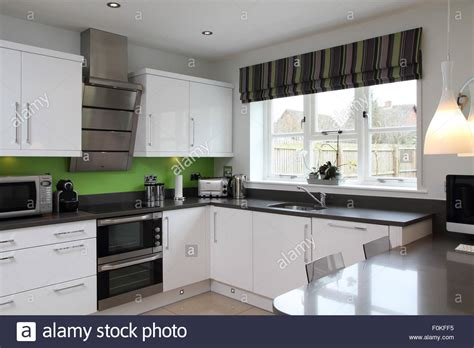 green black and white kitchen black and white modern kitchen with lime green splash back 6932