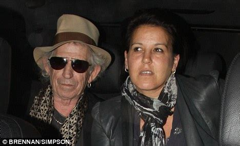 signing stones for wedding keith richards pictured in with child