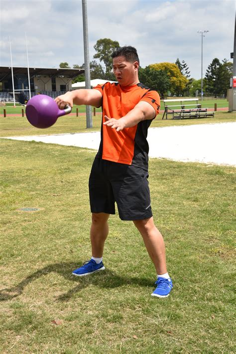 kettlebell swing hand step handed let arm swings upper body towards keep exercises exercise two thighs gravity move five thigh