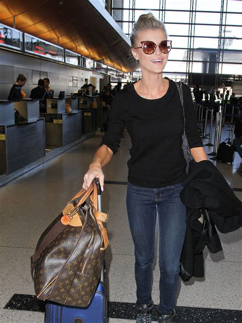 celebs carry   carry ons   bags  louis