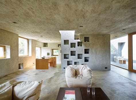 modern concrete house puntured  square windows digsdigs
