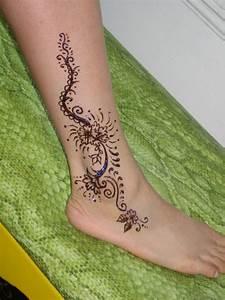 Little Henna Lotus Tattoo On Ankle | Tattooshunter.com