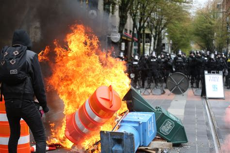 dozens arrested   day marches turn violent