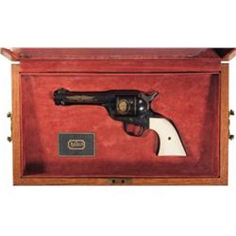cased colt single army wayne commemorative revolver with holster and gun belt