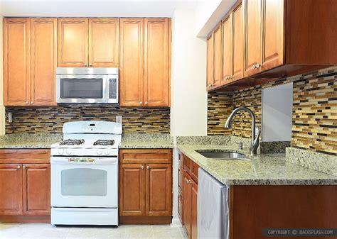 granite countertops with brown cabinets 6 new venetian gold granite brown cabinet backsplash tile