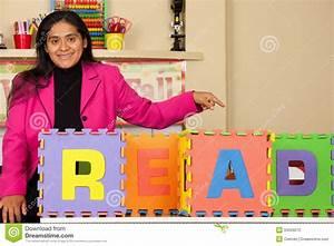 Hispanic Teacher Promoting Reading Stock Photo
