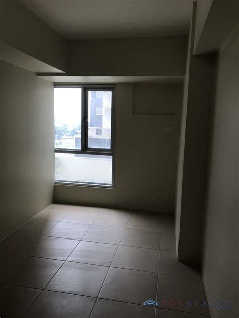top realty corporation brand   bedroom condo unit