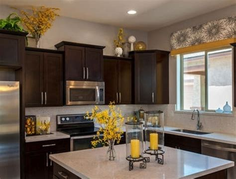 plants above kitchen cabinets greenery above kitchen cabinets ideas with decorative 8902