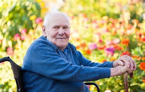 sad lonely senior elderly man in wheelchair aging stock