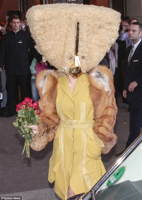 lady gaga leaves  hotel   triangular fur mask