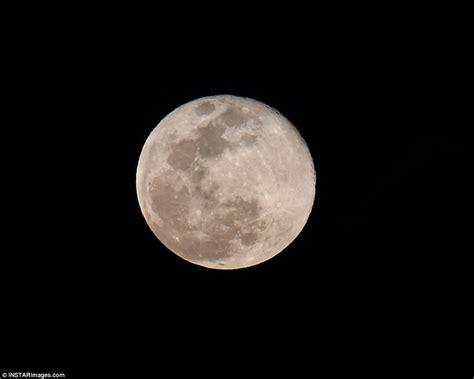 pink moon lights   sky   rises close  jupiter