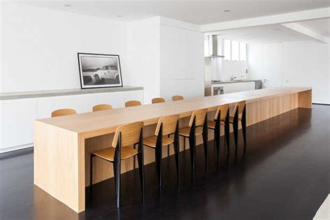 huge kitchen islanddining table takes center stage