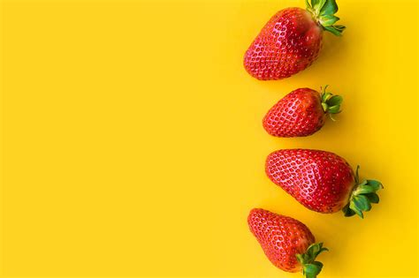 Strawberries With Yellow Background Free Stock Photo