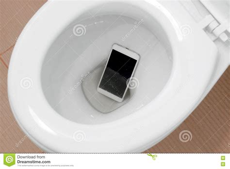 phone fell in toilet smartphone dropped into toilet stock photo image 80102725