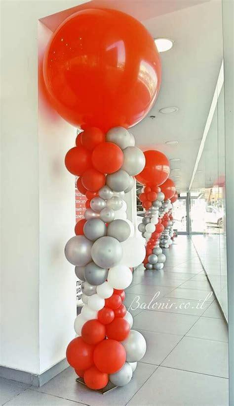 bright balloon columns  orange white  silver