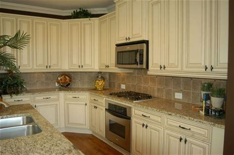 kitchen cabinets with light granite countertops antique white cabinets with st cecilia light granite 9837