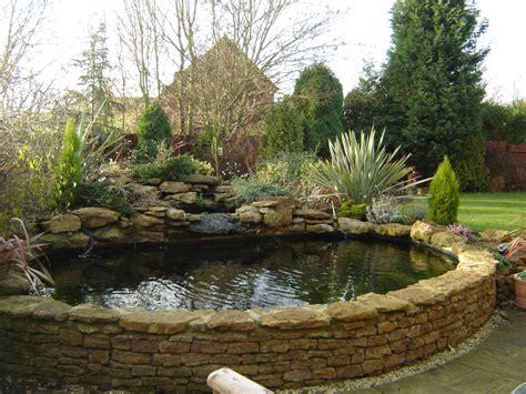 large raised oval koi pool   natural stone