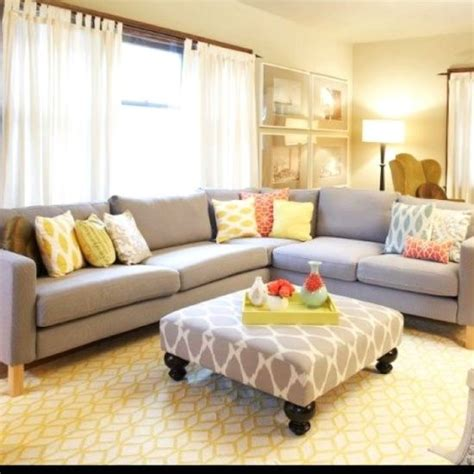 neutral furniture light and bright living room neutral furniture pops of color bold print on the ottoman for